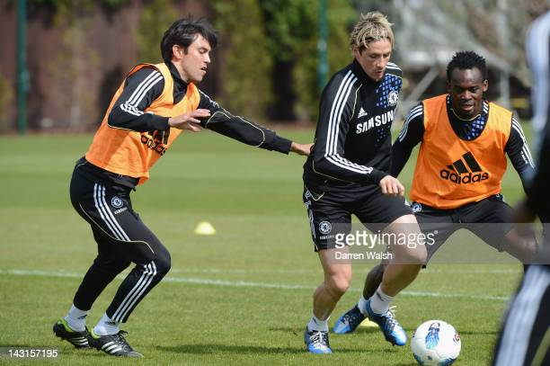 Paulo Ferreira Fernando Torres Michael Essien of Chelsea during a training session at the Cobham training ground on April 20 2012 in Cobham England