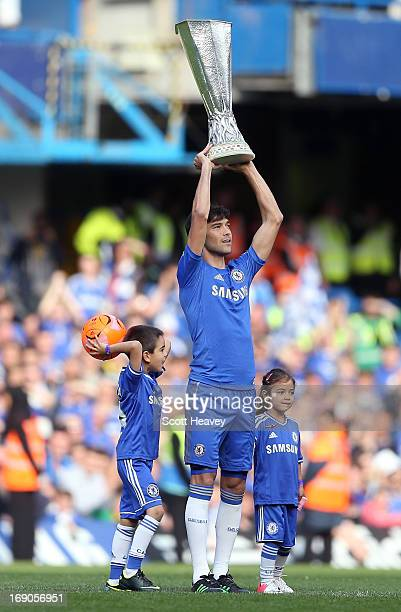 Paulo Ferreira of Chelsea holds aloft the UEFA Europa League trophy as he celebrates on the pitch after the Barclays Premier League match between...