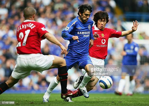Paulo Ferreira of Chelsea is challenged for the ball by Mikael Silvestre and JiSung Park of Manchester United during the Barclays Premiership match...