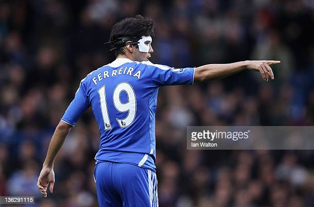 Paulo Ferreira of Chelsea points as he wears a protective mask during the Barclays Premier League match between Chelsea and Aston Villa at Stamford...