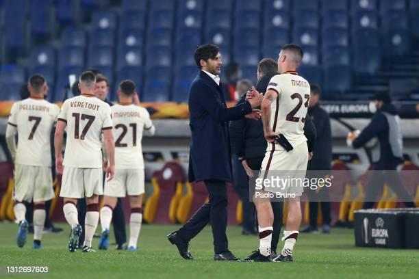 Paulo Fonseca, Head Coach of Roma and Gianluca Mancini of Roma celebrate following the UEFA Europa League Quarter Final Second Leg match between AS...