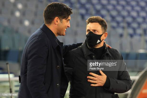 Paulo Fonseca, head coach of Roma interacts with Eusebio Di Francesco, head coach of Cagliari during the Serie A match between AS Roma and Cagliari...