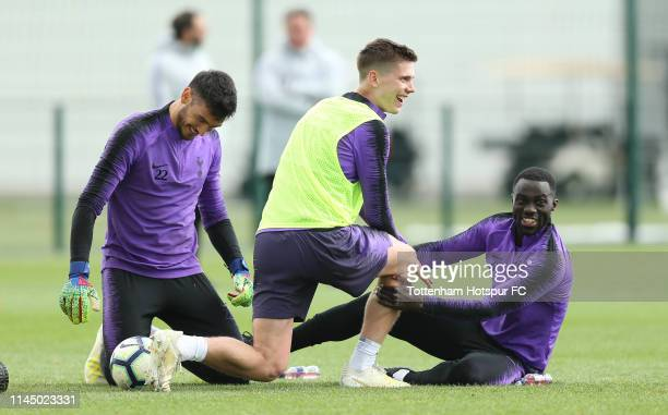 Paulo Gazzaniga, Juan Foyth and Davinson Sanchez of Tottenham Hotspur during the Tottenham Hotspur training session at Tottenham Hotspur Training...