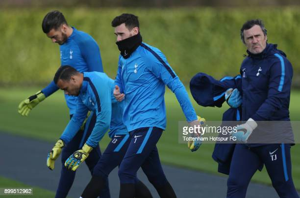 Paulo Gazzaniga Michel Vorm and Hugo Lloris of Tottenham Hotspur with goalkeeping coach Toni Jimenez during the Tottenham Hotspur training session at...