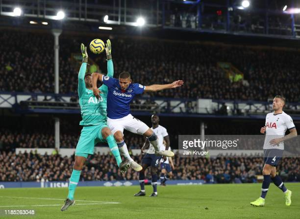 Paulo Gazzaniga of Tottenham Hotspur challenges for the high ball with Richarlison of Everton during the Premier League match between Everton FC and...