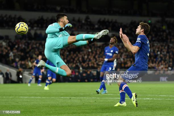 Paulo Gazzaniga of Tottenham Hotspur collides with Marcos Alonso of Chelsea in the area which results in a penalty awarded to Chelsea during the...