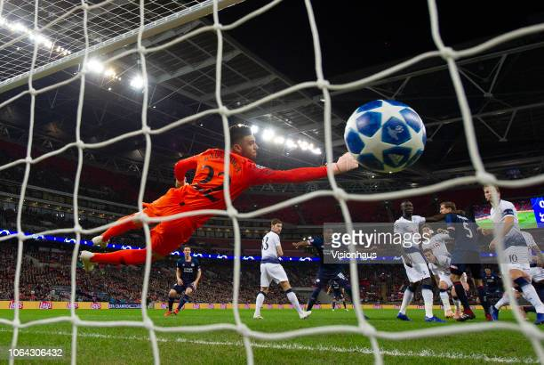 Paulo Gazzaniga of Tottenham Hotspur dives but fails to stop a header from PSV Eindhoven striker Luuk de Jong during the Group B match of the UEFA...