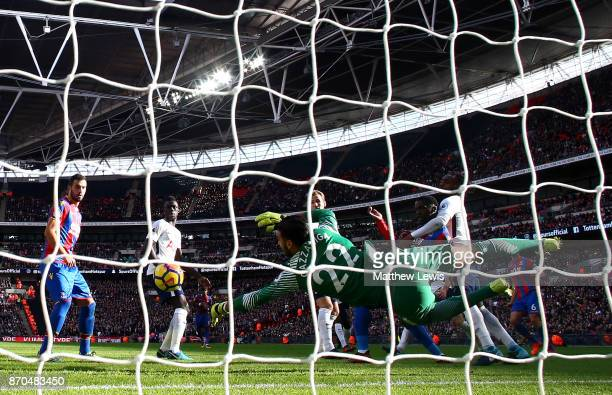 Paulo Gazzaniga of Tottenham Hotspur saves a shot from Jeffrey Schlupp of Crystal Palace during the Premier League match between Tottenham Hotspur...