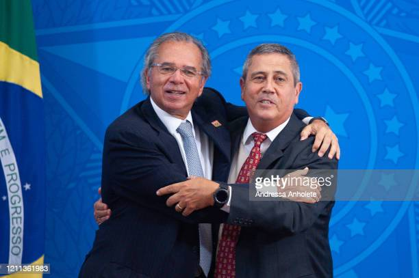 Paulo Guedes, Brazil's economy minister, and General Braga Netto, brazilian Chief of Staff of Presidency embrace at the end of the press...