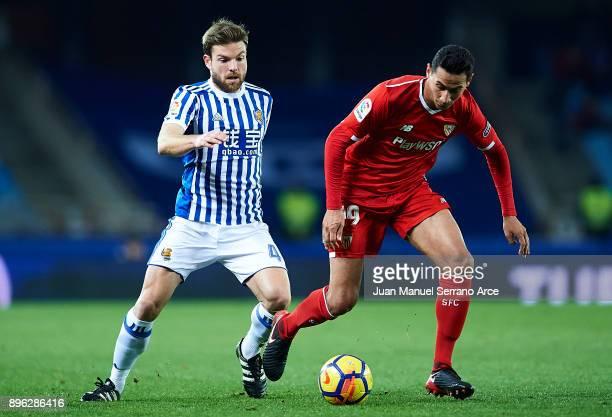 Paulo Henrique Ganso of Sevilla FC being followed by Asier Illarramendi of Real Sociedad during the La Liga match between Real Sociedad and Sevilla...