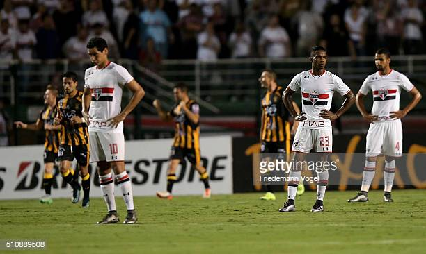 Paulo Henrique Ganso, Thiago Mendes and Lucao of Sao Paulo looks on during a match between Sao Paulo v The Strongest as part of Group 1 of Copa...