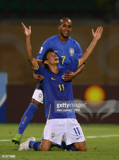 Paulo Henrique of Brazil celebrates with Alex Teixeira after scoring his goal during the FIFA U20 World Cup Group E match between Australia and...