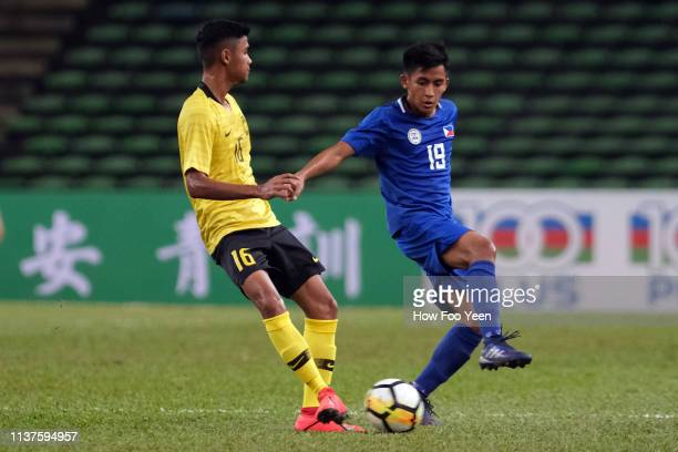 Paulo Javier of Malaysia and Roland Daniel Saavedra of the Phillipines in action during the AFC U23 Championship qualifier between Malaysia and...