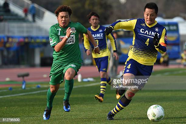 Paulo Junichi Tanaka of FC Gifu and Shunsuke Tsuhouchi of Thespa Kusatsu Gunma compete for the ball during the JLeague second division match between...