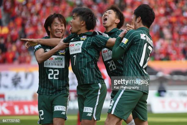 Paulo Junichi Tanaka of FC Gifu scores the opening goal with his team mates during the JLeague J2 match between Nagoya Grampus and FC Gifu at Toyota...