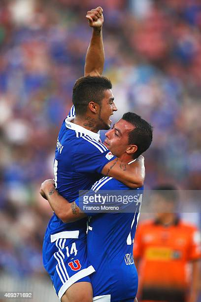 Paulo Magalhaes of Universidad de Chile celebrates with teammate Sebastian Ubilla after scoring the second goal of his team during a match between U...