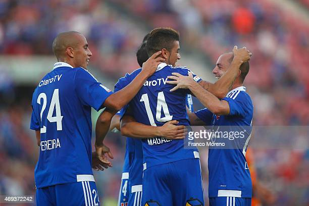 Paulo Magalhaes of Universidad de Chile celebrates with teammates after scoring the second goal of his team during a match between U de Chile and...