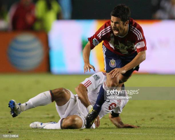 Paulo Nagamura of Chivas USA reacts from a hard tackle by Dwayne De Rosario of Toronto FC during the MLS match on October 9 2010 at the Home Depot...