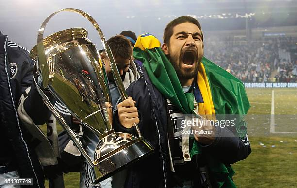 Paulo Nagamura of Sporting KC celebrates with the Philip F Anschutz trophy after defeating Real Salt Lake in a shootout to win the 2013 MLS Cup at...