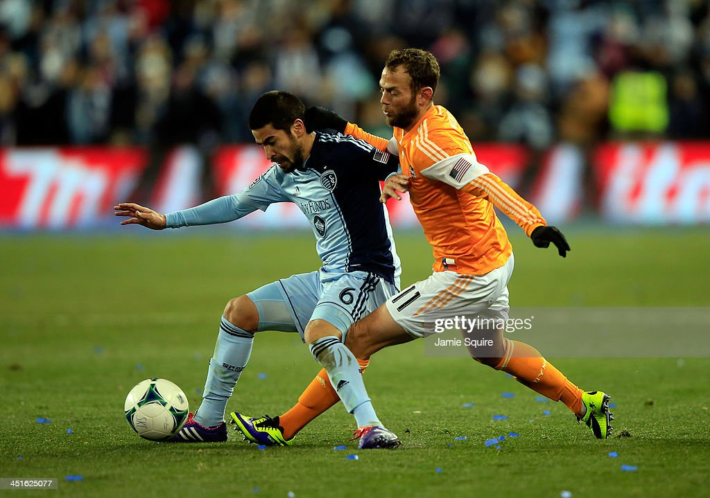 Paulo Nagamura #6 of the Sporting KC battles Brad Davis #11 of the Houston Dynamo for the ball during Leg 2 of the Eastern Conference Championship at Sporting Park on November 23, 2013 in Kansas City, Kansas.