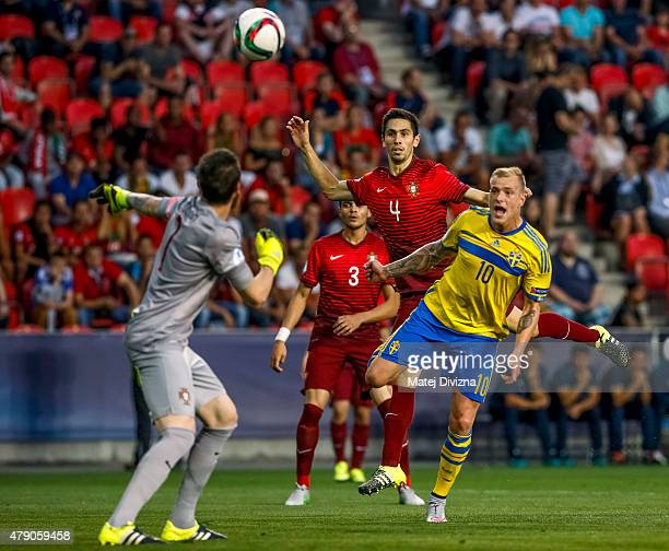 Paulo Oliveira and Jose Sa of Portugal battle for the ball with John Guidetti of Sweden during UEFA U21 European Championship final match between...