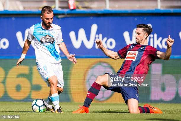 Paulo Oliveira of SD Eibar duels for the ball with Emre Colak of RC Deportivo La Coruna during the La Liga match between SD Eibar and RC Deportivo La...