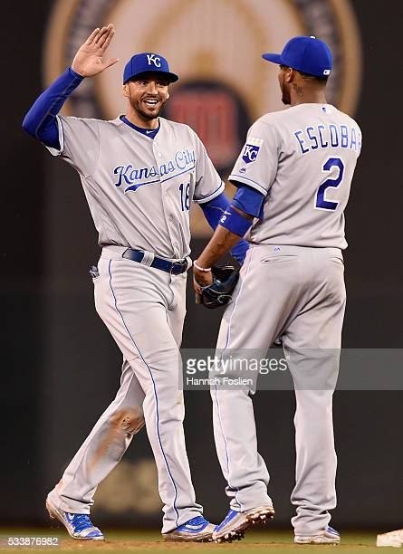 Paulo Orlando and Alcides Escobar of the Kansas City Royals celebrate a win of the game against the Minnesota Twins on May 23, 2016 at Target Field...
