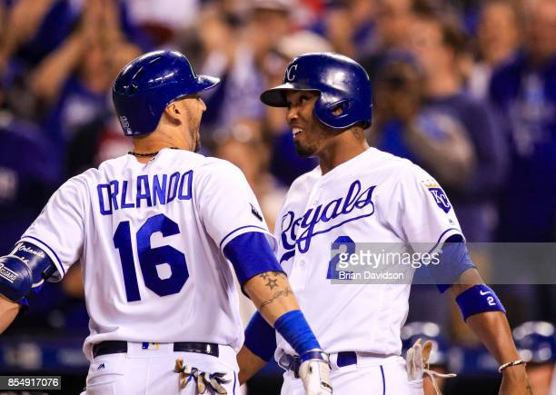 Paulo Orlando and Alcides Escobar of the Kansas City Royals celebrate scoring against the Detroit Tigers during the seventh inning at Kauffman...