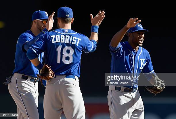 Paulo Orlando Ben Zobrist and Lorenzo Cain of the Kansas City Royals celebrate a win of the game against the Minnesota Twins on October 3 2015 at...