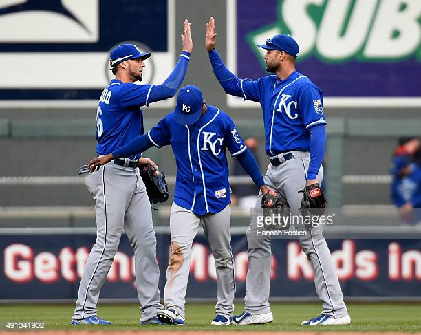 Paulo Orlando Jarrod Dyson and Alex Rios of the Kansas City Royals celebrate a win of the game against the Minnesota Twins on October 4 2015 at...