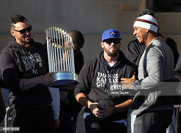 Paulo Orlando Mike Moustakas and Salvador Perez entertain the crowd with the trophy during a parade and celebration in honor of the Kansas City...
