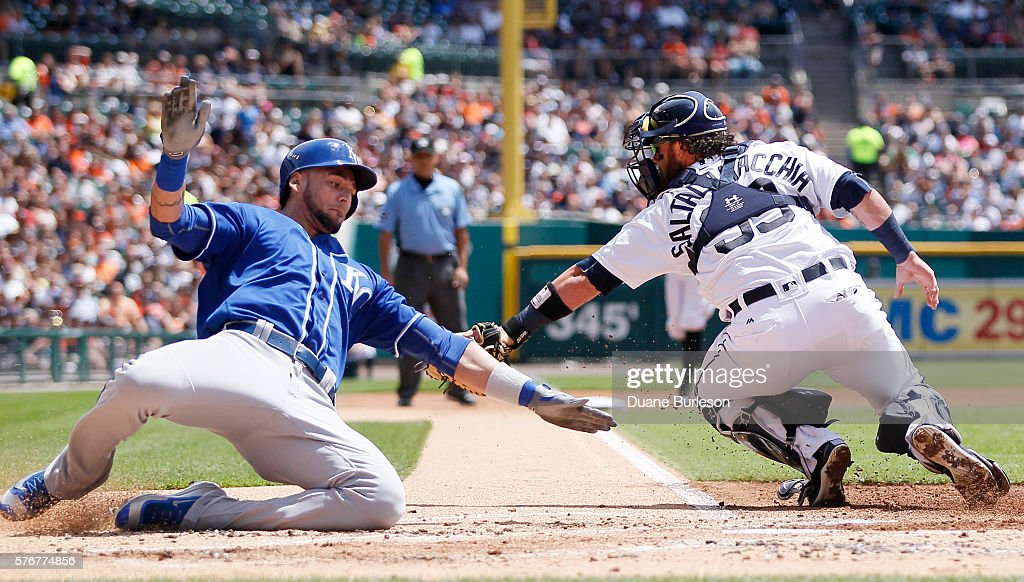 Paulo Orlando #16 of the Kansas City Royals avoids the tag from catcher Jarrod Saltalamacchia #39 of the Detroit Tigers to score from first base on a double by Cheslor Cuthbert of the Kansas City Royals during the second inning at Comerica Park on July 17, 2016 in Detroit, Michigan.