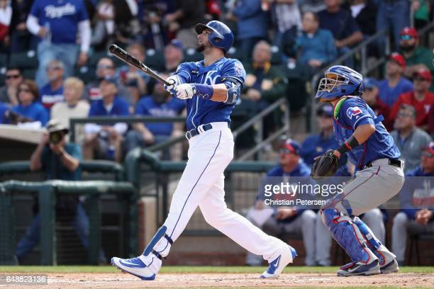 Paulo Orlando of the Kansas City Royals bats against the Texas Rangers during the spring training game at Surprise Stadium on February 26 2017 in...