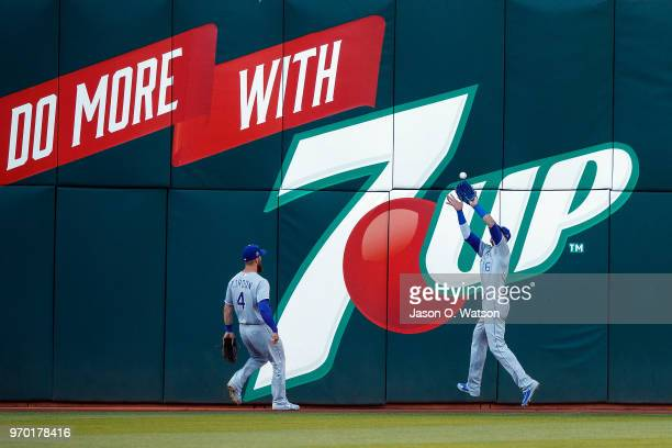 Paulo Orlando of the Kansas City Royals catches a fly ball hit off the bat of Jed Lowrie of the Oakland Athletics during the first inning at the...
