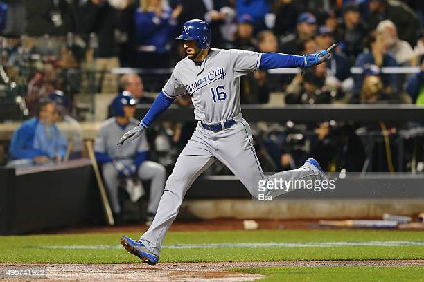 Paulo Orlando of the Kansas City Royals celebrates scoring a run in the twelfth inning against the New York Mets during Game Five of the 2015 World...