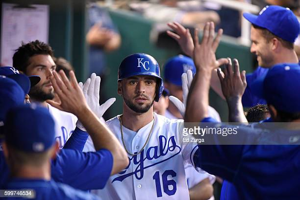 Paulo Orlando of the Kansas City Royals celebrates with teammates after scoring against the New York Yankees at Kauffman Stadium on August 31, 2016...