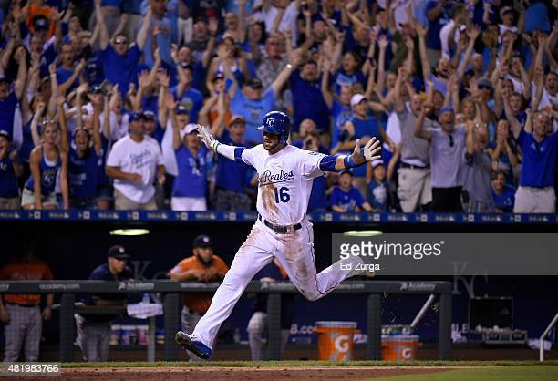 Paulo Orlando of the Kansas City Royals crosses home as he scores the game-winning run in the 10th inning against the Houston Astros at Kauffman...