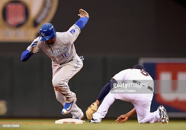 Paulo Orlando of the Kansas City Royals heads to third base after stealing second base and the ball getting past Eduardo Escobar of the Minnesota...