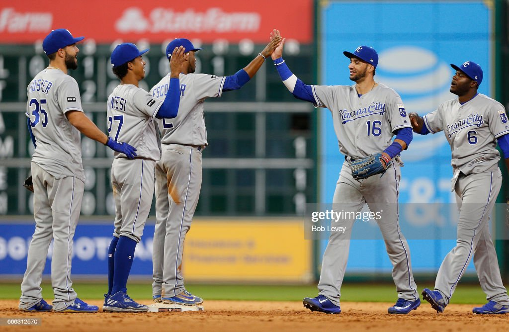 Paulo Orlando #16 of the Kansas City Royals high fives Alcides Escobar #2 along with Raul Mondesi #27, Eric Hosmer #35 and Lorenzo Cain #6 after defeating the Houston Astros 7-3 at Minute Maid Park on April 8, 2017 in Houston, Texas.
