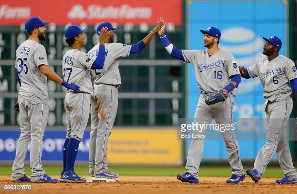 Paulo Orlando of the Kansas City Royals high fives Alcides Escobar along with Raul Mondesi Eric Hosmer and Lorenzo Cain after defeating the Houston...