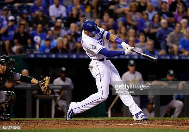 Paulo Orlando of the Kansas City Royals hits a single to drive in two runs during the 4th inning of the game against the Oakland Athletics at...
