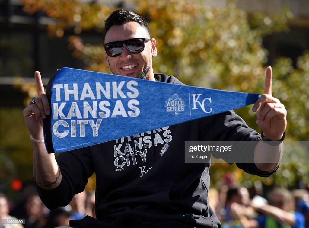 Paulo Orlando #16 of the Kansas City Royals holds up a pennate as he thanks fans during a parade to celebrate their World Series victory on November 3, 2015 in Kansas City, Missouri.