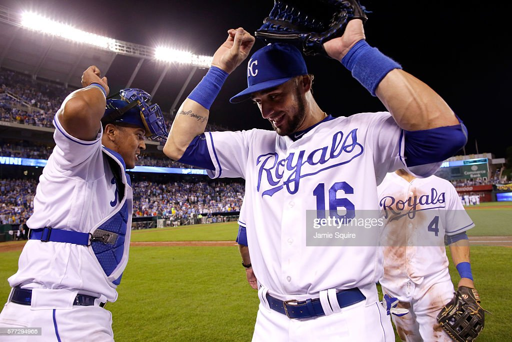 Paulo Orlando #16 of the Kansas City Royals is congratulated by catcher Salvador Perez #13 after the Royals defeated the Cleveland Indians 7-3-to win the game against the Cleveland Indians at Kauffman Stadium on July 18, 2016 in Kansas City, Missouri.