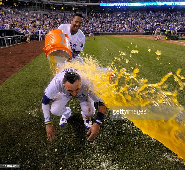 Paulo Orlando of the Kansas City Royals is doused with Gatorade by Salvador Perez as they celebrate a 2-1 win over the Houston Astros in 10 innings...