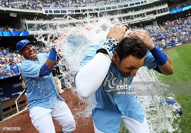 Paulo Orlando of the Kansas City Royals is doused with water by catcher Salvador Perez after hitting a walk-off grand slam in the bottom of the 9th...