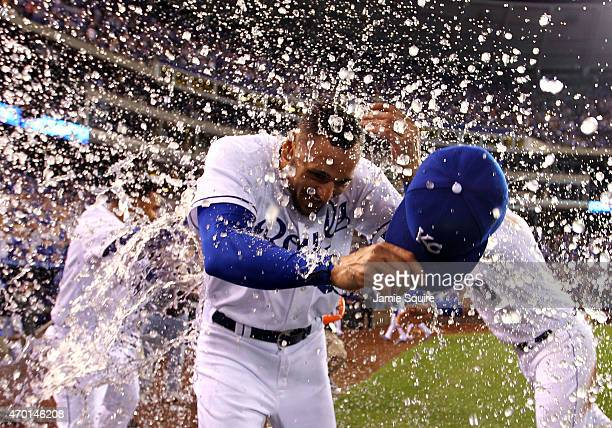 Paulo Orlando of the Kansas City Royals is doused with water by teammates after the Royals defeated the Oakland Athletics 6-4 to win the game at...