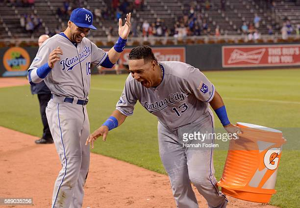 Paulo Orlando of the Kansas City Royals reacts after teammate Salvador Perez poured ice water on him to celebrate winning the game against the...