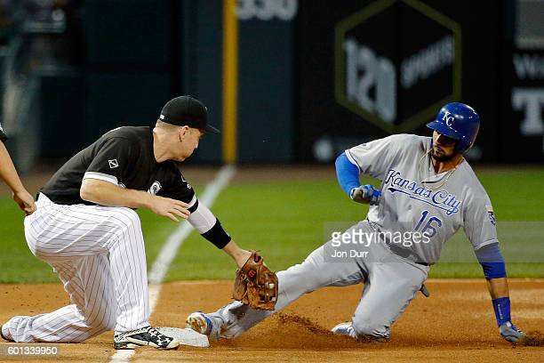 Paulo Orlando of the Kansas City Royals slides safely into third base as Todd Frazier of the Chicago White Sox is unable to apply the tag in time...