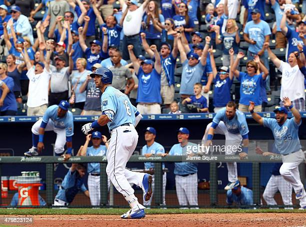 Paulo Orlando of the Kansas City Royals watchs the ball fly over the wall as he hits a walkoff grand slam in the bottom of the 9th inning during game...