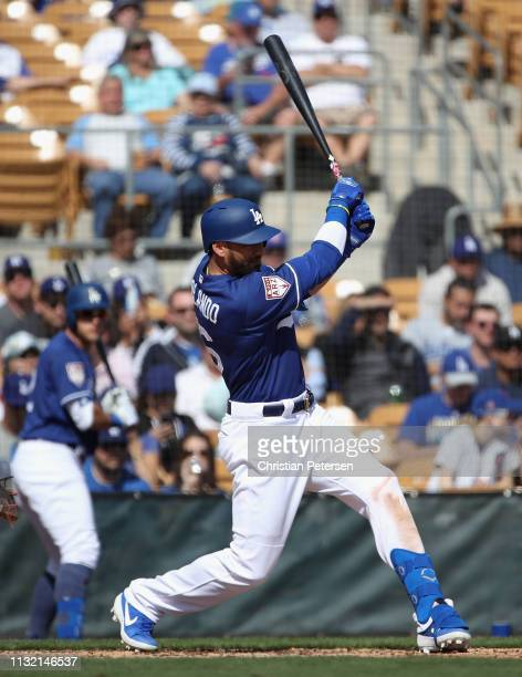 Paulo Orlando of the Los Angeles Dodgers hits a sacrifice fly during the third inning of the MLB spring training game against the Chicago Cubs at...